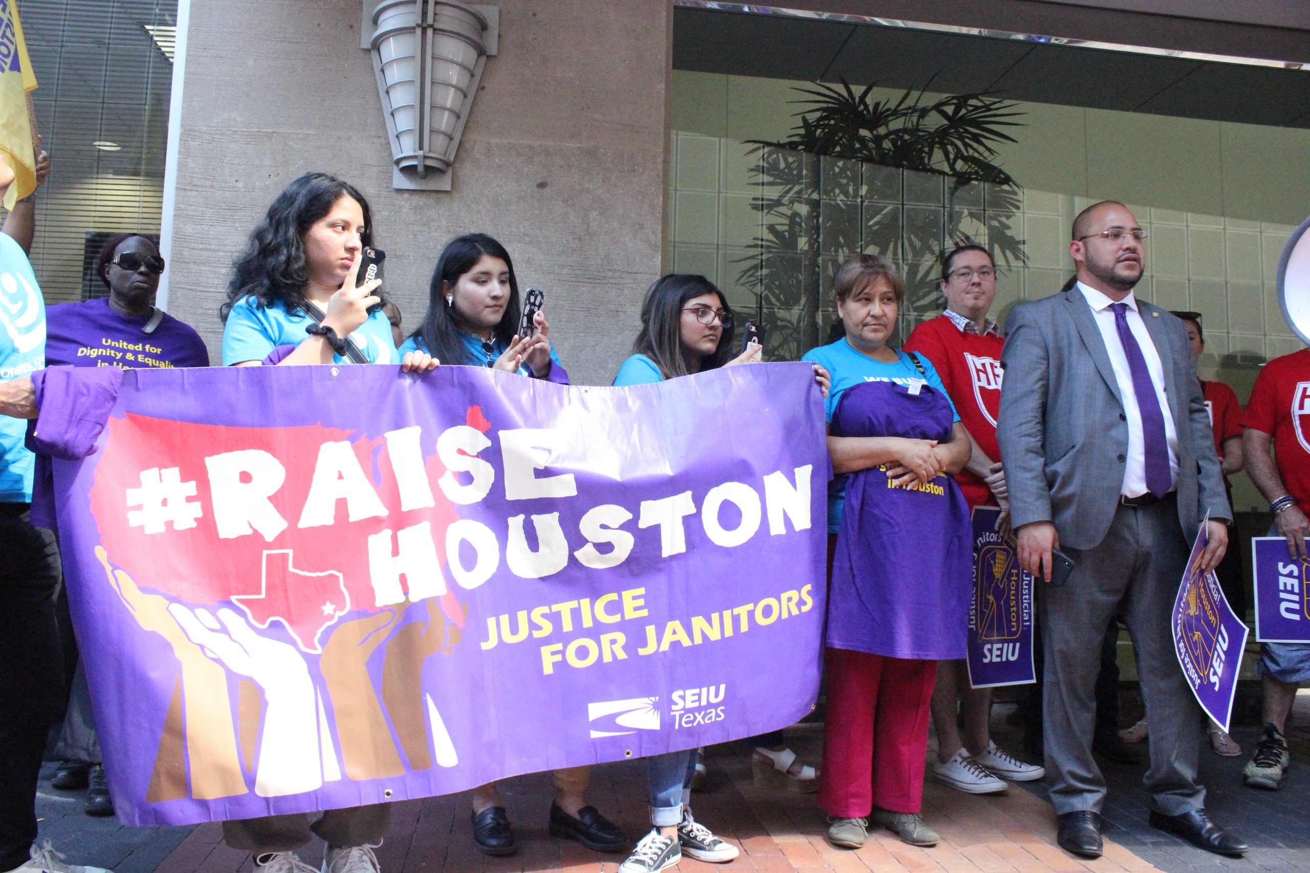 Cleaning workers and janitors demonstrate in downtown Houston to demand better working conditions